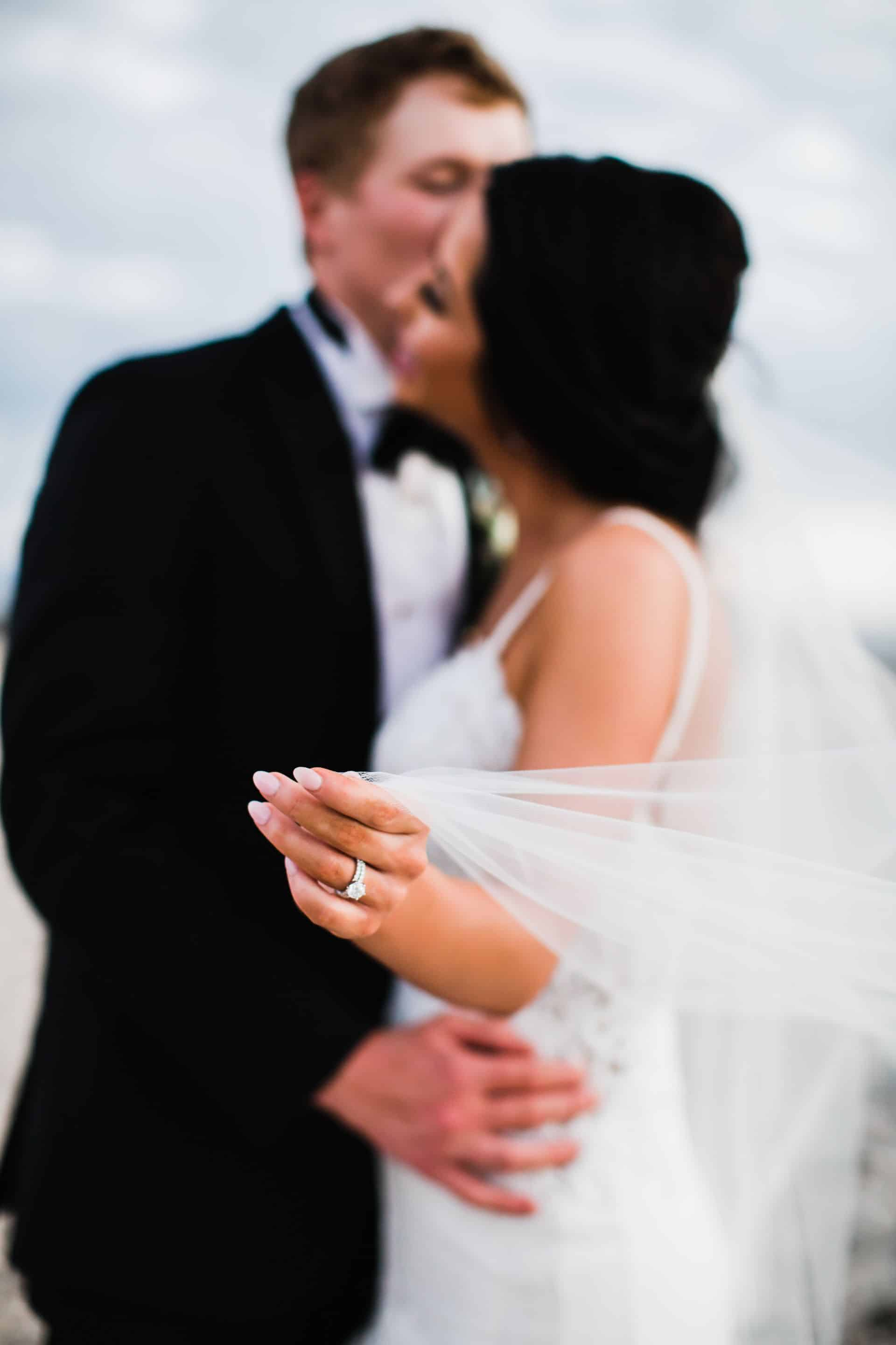 Bride and groom detail shot with veil | Maui's Angels