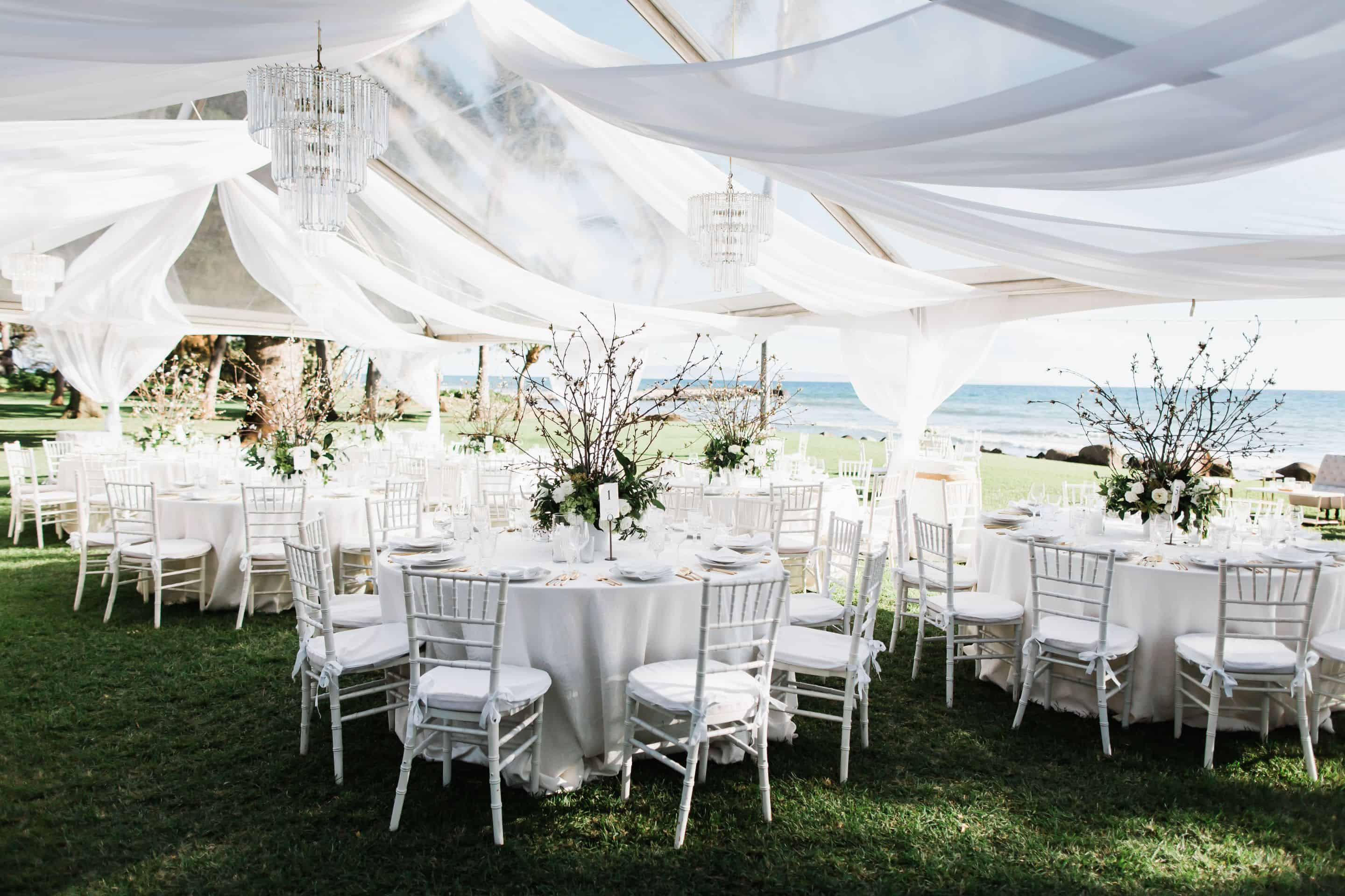 White wedding reception overlooking ocean | Maui's Angels