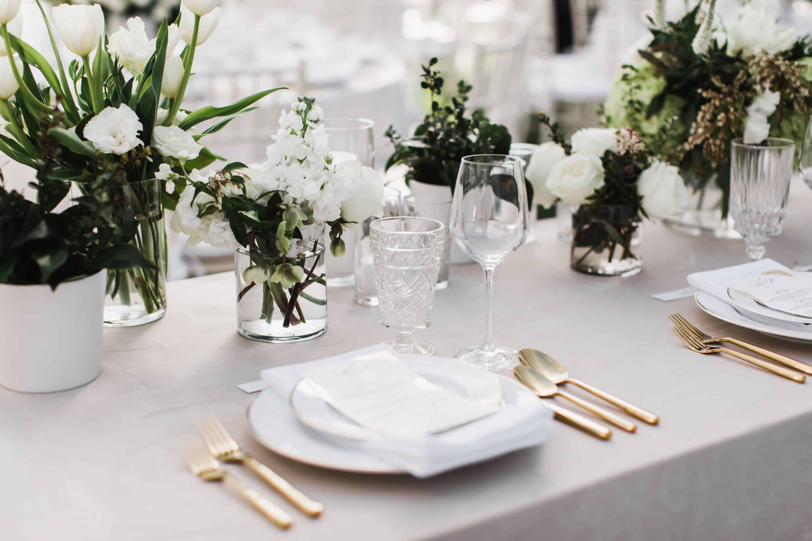 Wedding reception tablescape with gold flatware | Maui's Angels
