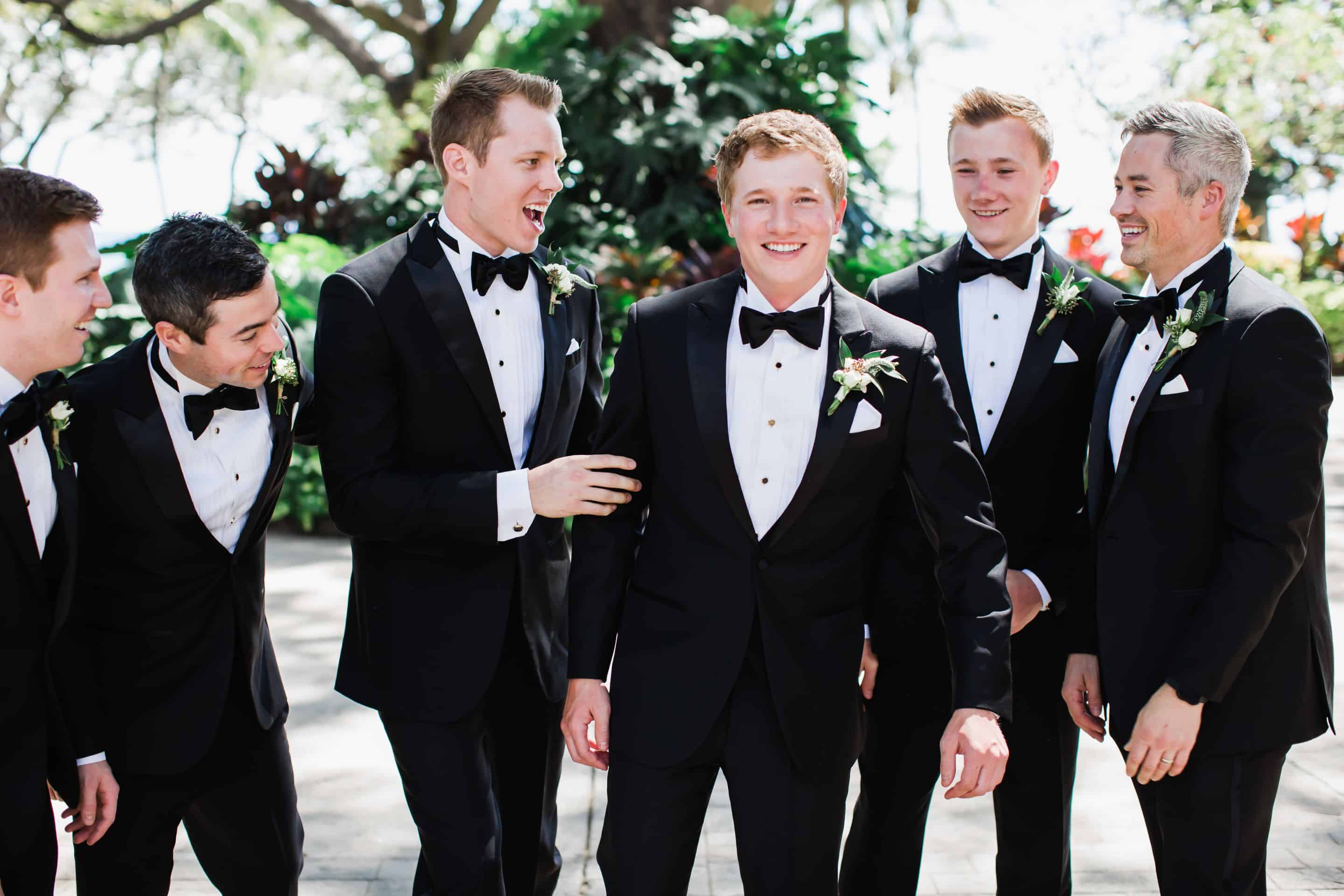 Destination groomsmen in black tuxedos and bow ties | Maui's Angels